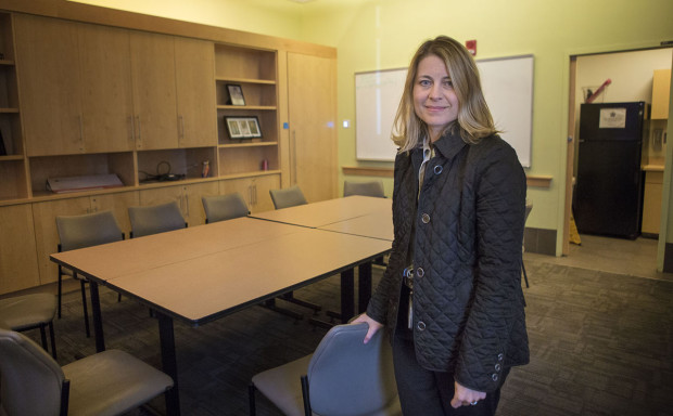 Dr. Jessie Gaeta, chief medical officer of the Boston Health Care for the Homeless Program, stands in a conference room, where the SPOT Center will be at 780 Albany Street. (Jesse Costa/WBUR)