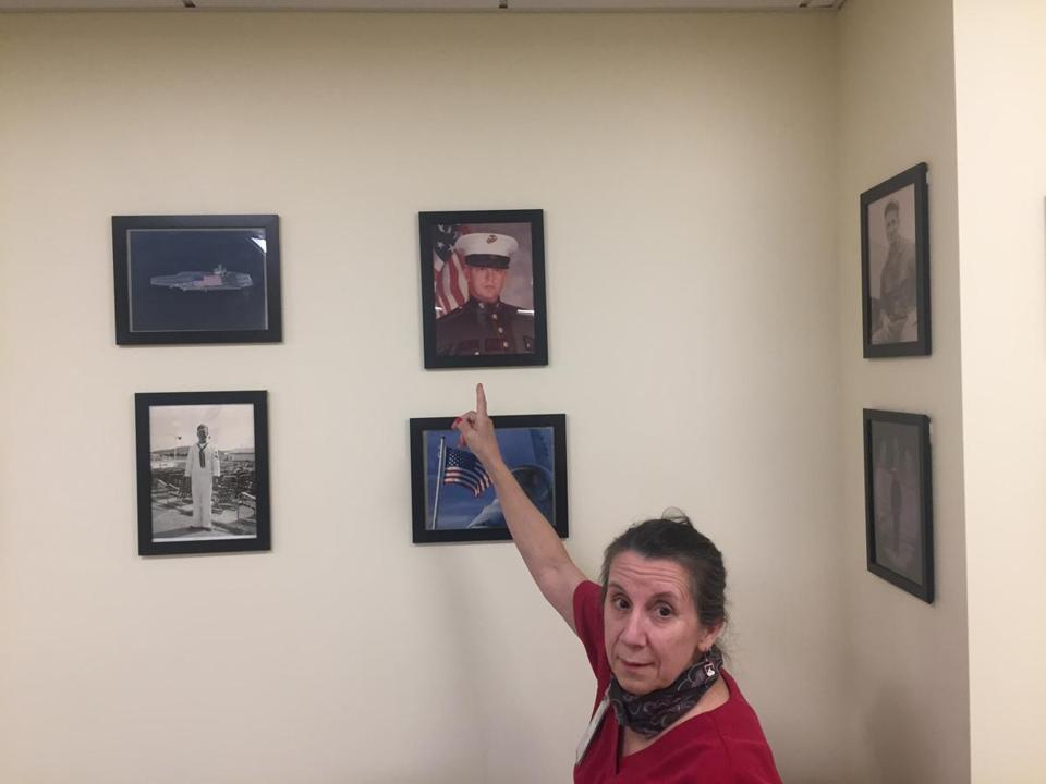 Sharon Morrison points at photos in NECHV credit Kevin Cullen Globe Staff